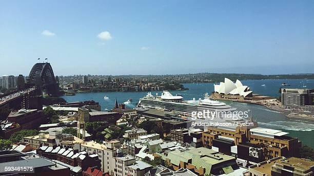 Cruise Ship Moored At Harbor By Sydney Opera House Against Sky