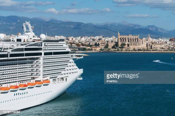 cruise ship moored at the port of palma de mallorca - palma majorca stock pictures, royalty-free photos & images
