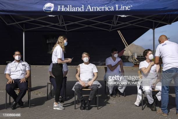 Cruise ship Oosterdam crew members receives a dose of the Janssen Covid-19 vaccine in IJmuiden on July 8, 2021 on the first day of coronavirus...