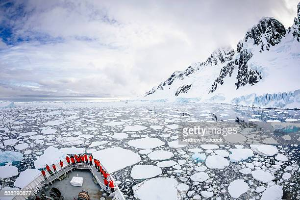 a cruise ship passes booth island - antarctica stock pictures, royalty-free photos & images