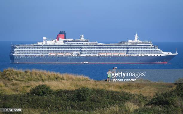 Cruise ship Queen Victoria anchored in the English Channel off the Dorset coast as the industry remains at a standstill due to the coronavirus...
