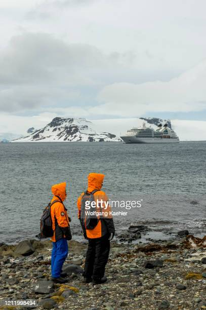 Cruise ship Seabourn Quest at the Polish research station Arctowski on King George Island in the South Shetland Island group, Antarctica with...