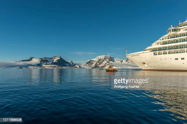 Cruise ship Seabourn Quest with passengers in zodiac in the Antarctic Sound at Hope Bay in the Antarctic Peninsula region.
