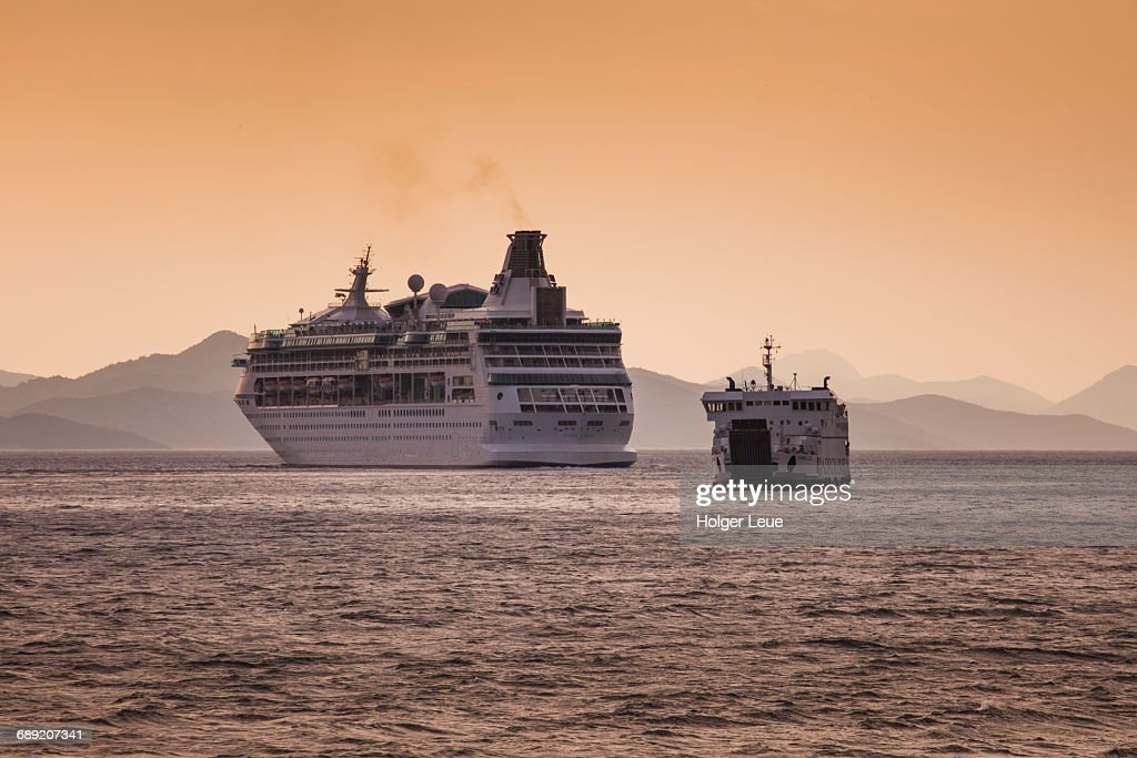 Cruise ship Vision of the Seas and ferry at sunset : Stock Photo