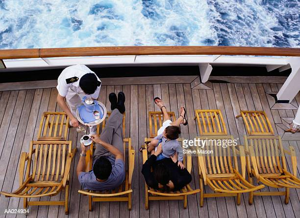 cruise ship waiter serving coffee to a passengers - cruise ship stock pictures, royalty-free photos & images