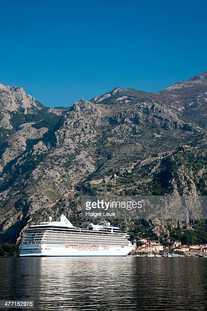 cruise ship with fortress and mountains - kotor bay stock pictures, royalty-free photos & images