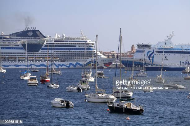 Cruise ships and a ferry are seen docked in the port of Ajaccio on the French Mediterranean island of Corsica on July 26 2018