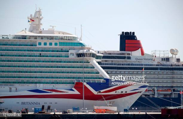 Cruise ships Britannia and Queen Victoria are pictured moored to the quayside at the Eastern Docks in Southampton on April 20 as life in Britain...