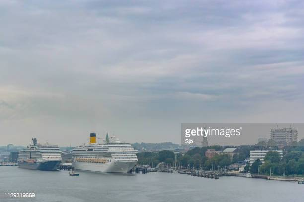 cruise ships costa pacifica and ms eurodam of the holland america line moored in the port of kiel in germany - dalsland stock photos and pictures