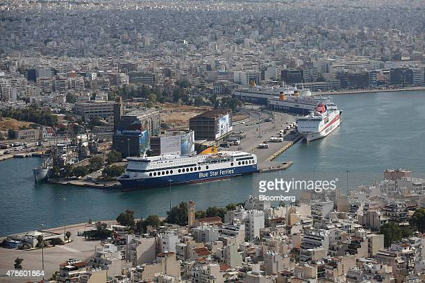 Cruise ships operated by Blue Star Ferries Maritime SA sit on the dockside at the commercial ferry port in Athens Greece on Thursday June 25 2015...
