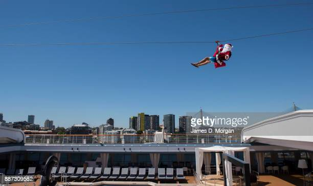 Cruises receive an early visit from Father Christmas who swapped his Christmas sleigh for a thrillseeking ride down the 70m flying fox onboard...