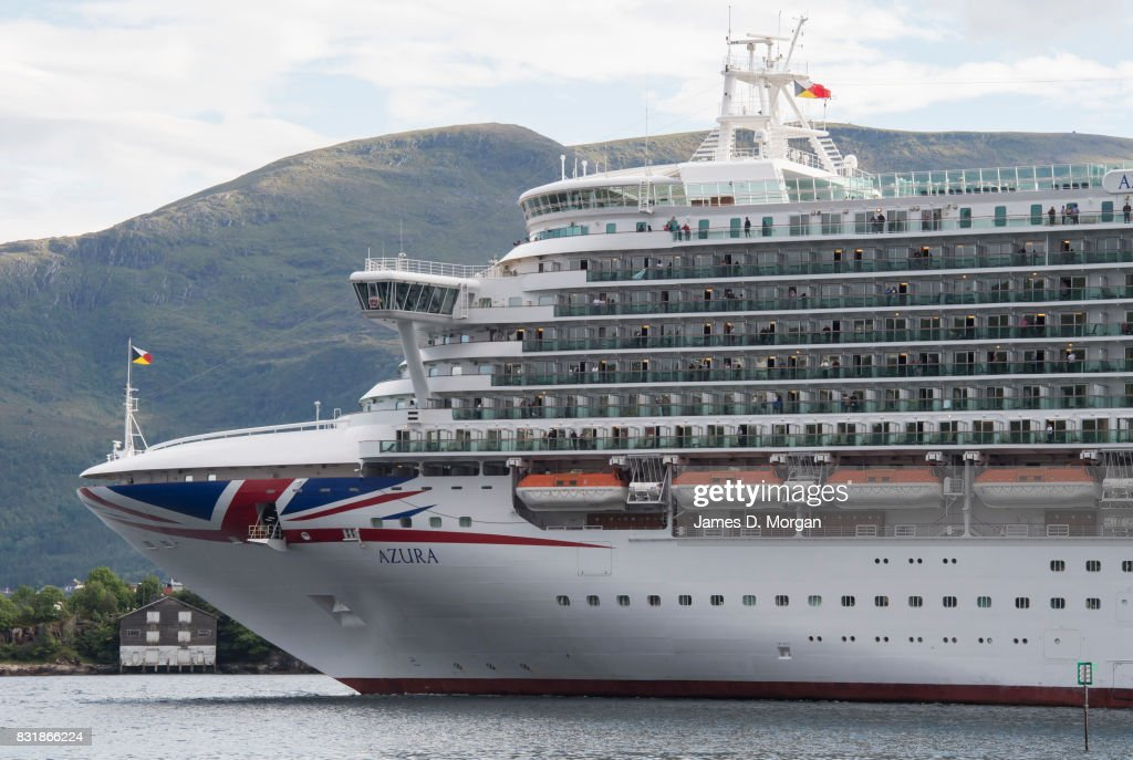 Cruises ship, Azura, departs port on her seven day cruise from Southampton on August 15, 2017 in Alesund, Norway. With over 3000 guests and 1200 crew, the 115,000 tonne ship is on a seven day Norweigian fjord cruise from Southamton arriving back on the 19th August 2017. Summer is a popular time for the Norweigan Fjord cruise industry with dozens of cruise ships in the waters off Norway with tens of thousands of visitors disembarking every day.