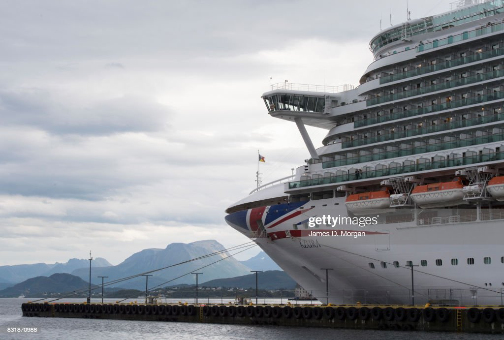 Cruises ship, Azura, prepares to depart port on her seven day cruise from Southampton on August 15, 2017 in Alesund, Norway. With over 3000 guests and 1200 crew, the 115,000 tonne ship is on a seven day Norweigian fjord cruise from Southamton arriving back on the 19th August 2017. Summer is a popular time for the Norweigan Fjord cruise industry with dozens of cruise ships in the waters off Norway with tens of thousands of visitors disembarking every day.