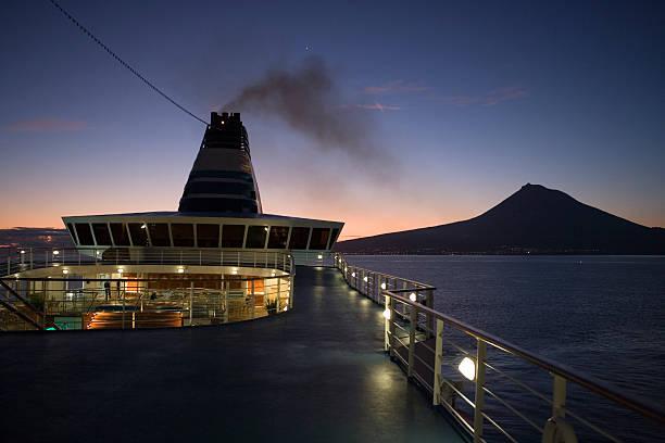 Cruiseship Delphin Voyager passing Pico Island at dawn.
