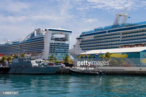Cruiseships Caribbean Princess And Coral Princess At Pier Stock - Cruise ships in aruba
