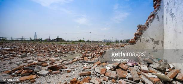 crumbling brick wall against blue sky,horizonal view - demolishing stock pictures, royalty-free photos & images