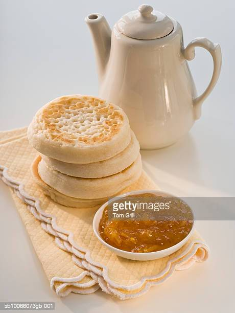 Crumpets with marmalade and teapot, close-up