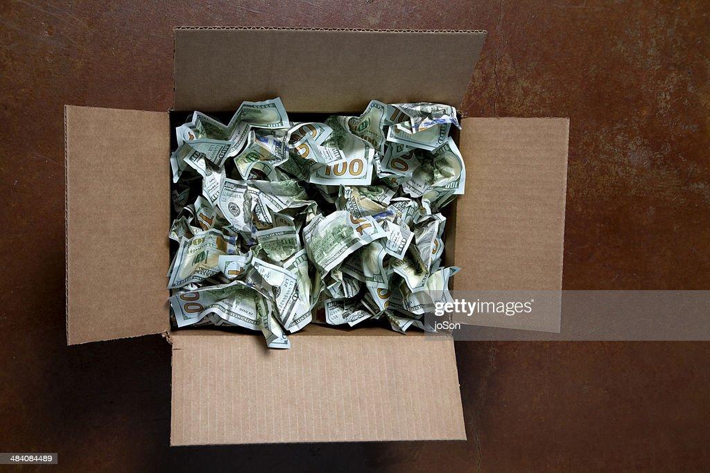 Crumpled 100 USD bills in box : Stock Photo