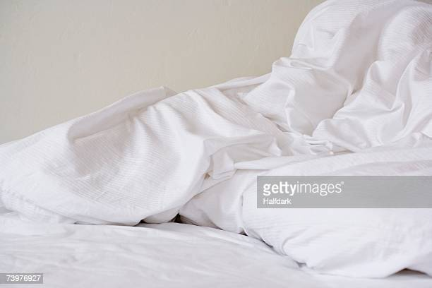 Crumpled bed sheets