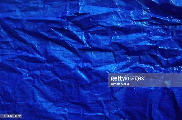 Crumpled blue plastic tarpaulin