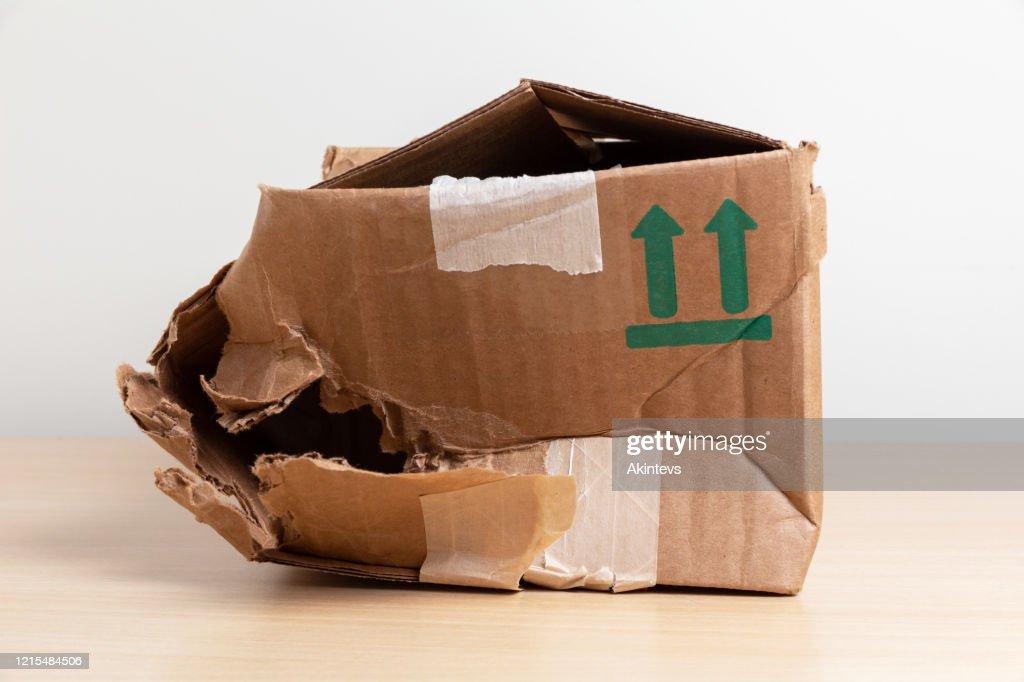 crumpled cardboard mail box : Stock Photo