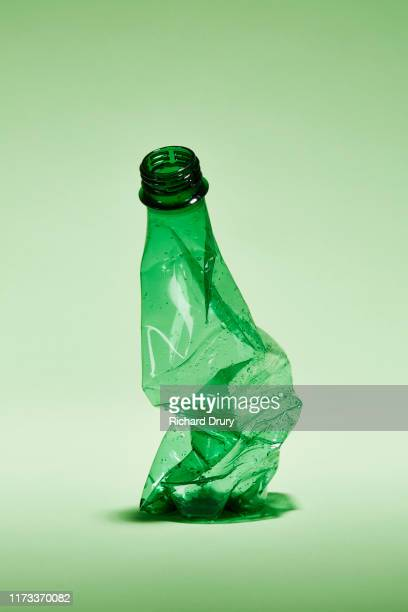 a crumpled disposable water bottle - plastic stock pictures, royalty-free photos & images