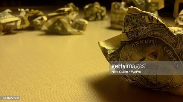 Crumpled Dollar Banknotes On Table