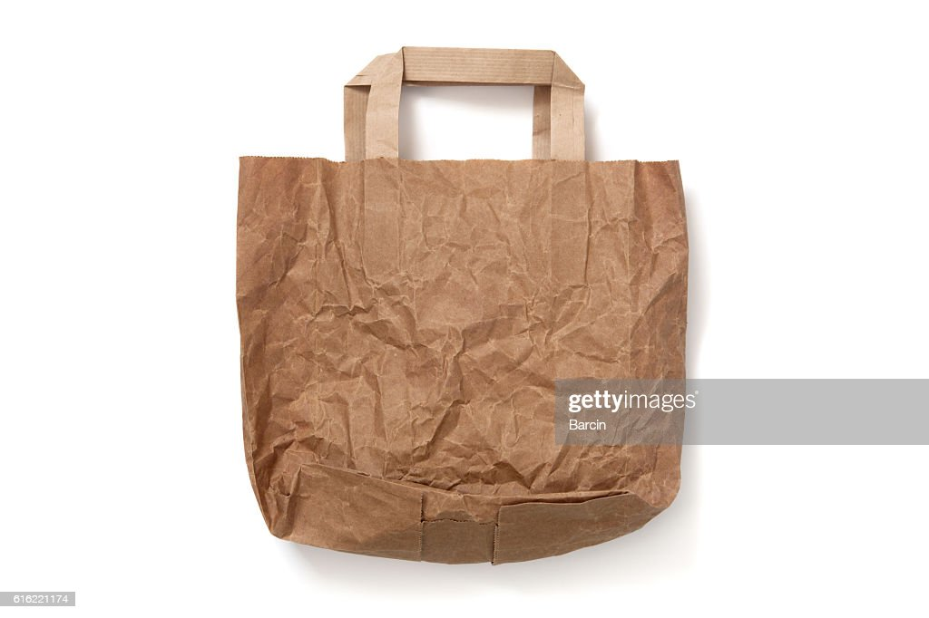 Crumpled empty brown paper shopping bag on white background : ストックフォト