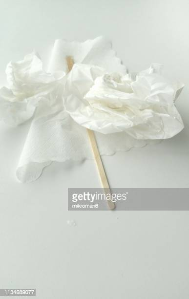 crumpled napkin on white table - paper napkin stock photos and pictures