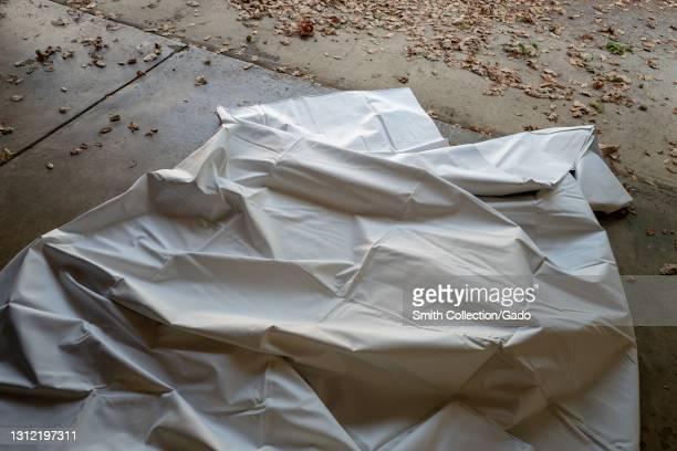 Crumpled painter's dropcloth on garage floor, Lafayette, California, November 17, 2020.