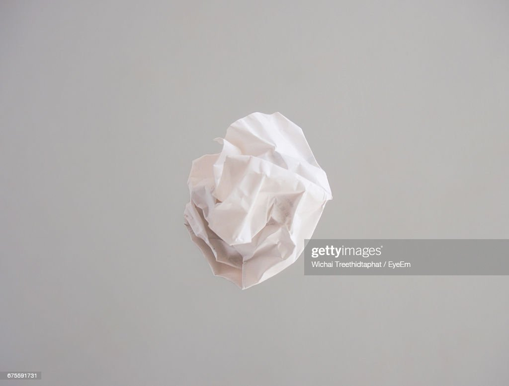 Crumpled Paper Against Gray Background : Stock Photo