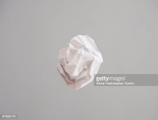Crumpled Paper Against Gray Background