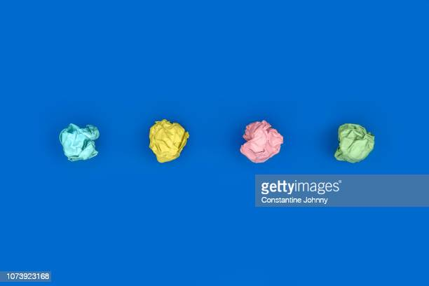 crumpled paper balls arranged in a row - veto stock pictures, royalty-free photos & images