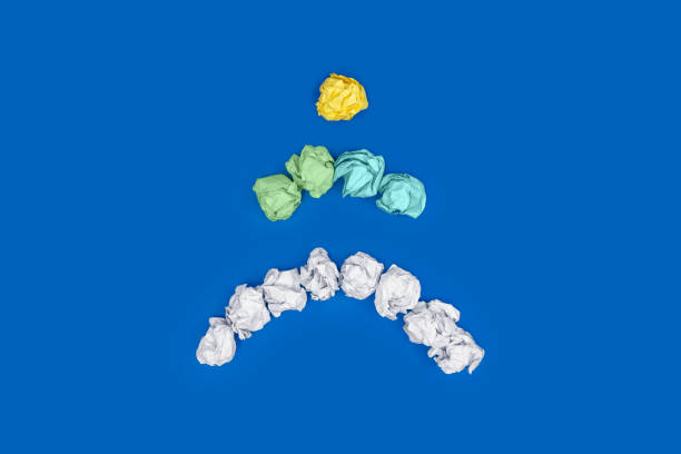 Crumpled Paper Balls Over Blue Background.