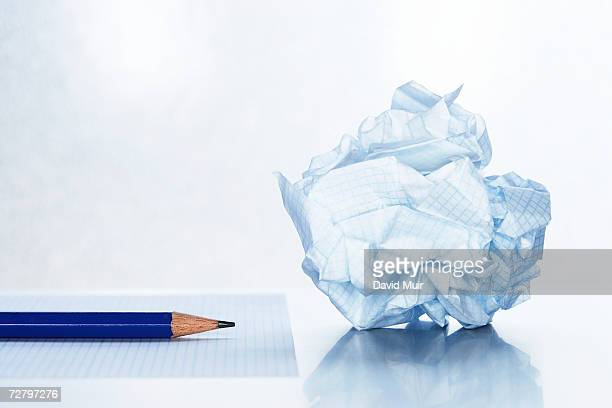 Crumpled paper by pencil on blank sheet