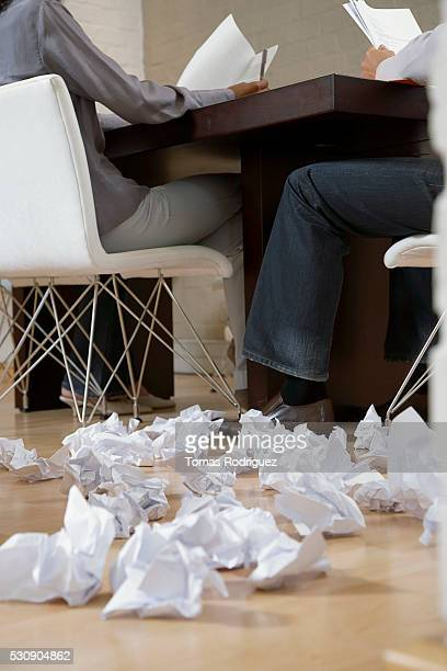 Crumpled paper in a meeting room