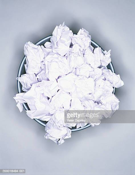 Crumpled paper in wastepaper bin, view from above