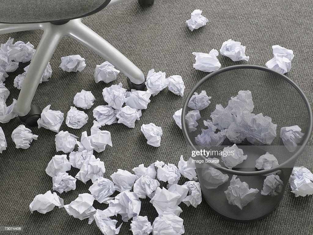 Crumpled paper on floor : Stock Photo