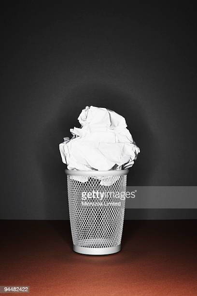 crumpled paper on top of trash can - microzoa stock pictures, royalty-free photos & images