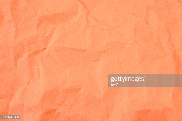 crumpled paper - orange background stock pictures, royalty-free photos & images