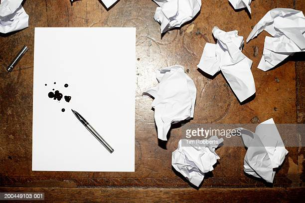 crumpled papers and ink splotches on paper, overhead view - fountain pen stock pictures, royalty-free photos & images