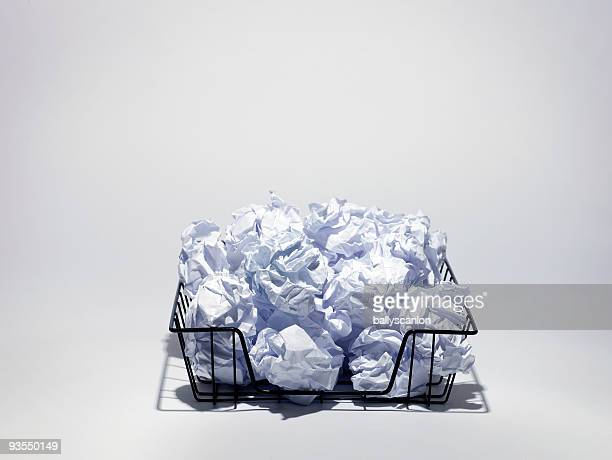 Crumpled Papers in Wire Basket.