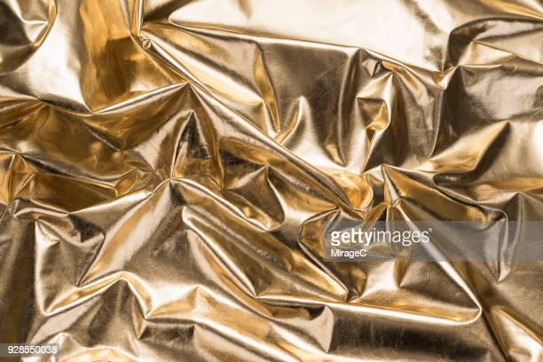 Crumpled Shiny Gold Colored Textile Texture