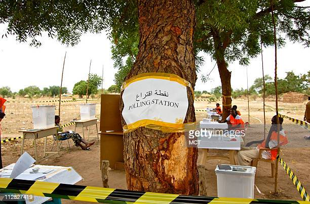 A crumpled sign taped haphazardly around a tree outside Terekeka southern Sudan indicates the location of one empty polling station on April 11 The...
