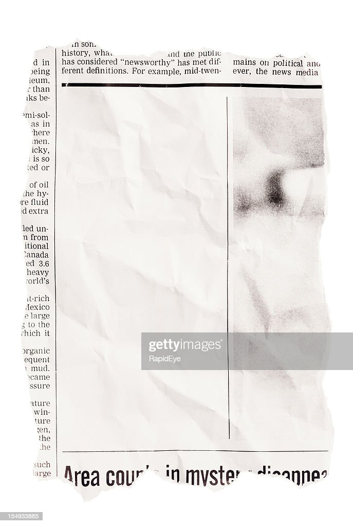 Crumpled torn out newspaper clipping with blank space : Stock Photo