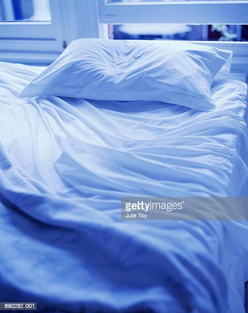 Crumpled unmade bed, close-up