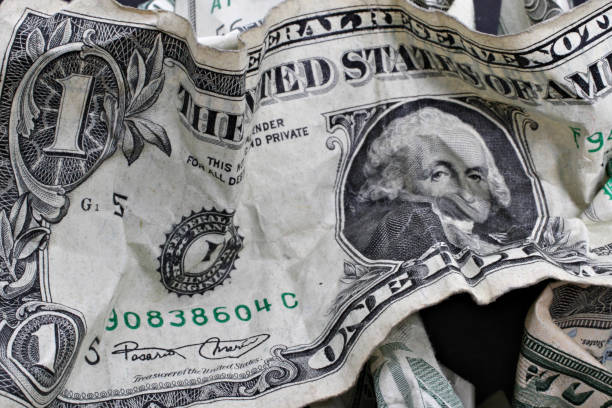 Crumpled U S Currency Including A One Dollar Bill Is Arrang