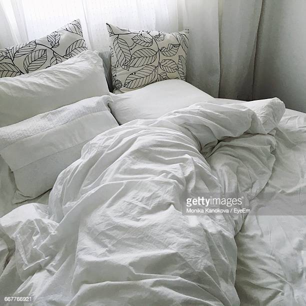 Crumpled White Sheet On Bed At Home