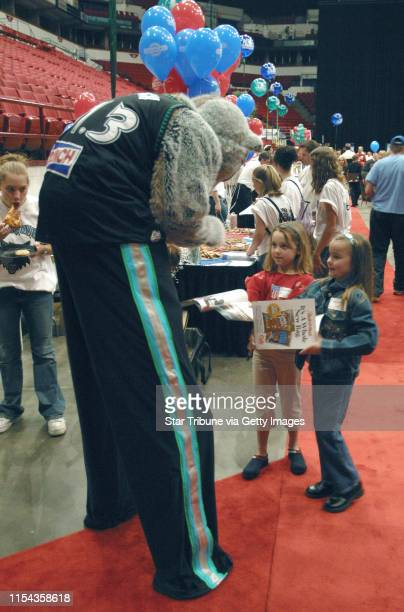 Crunch, the team mascot, signs an autographs for Elizabeth Swenson and Clare Seeman . The girls are from Excelsior. GENERAL INFORMATION: Minneapolis,...