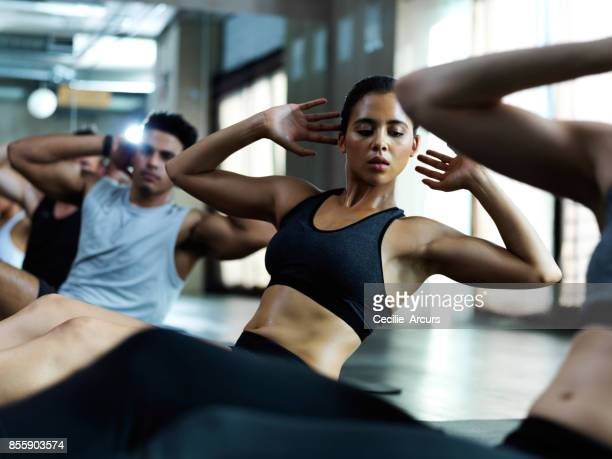 crunches make solid cores - sit ups stock photos and pictures